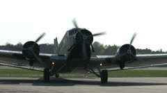 Historic military airplane ju 52 turning on taxiway Stock Footage