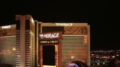 Mirage Hotel Resort Casino Las Vegas Nevada night pan HD 6528 Stock Footage