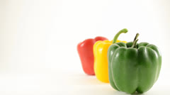 Green, Yellow and Red Peppers Against White - Crane Down Stock Footage
