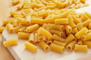 Stock Photo of uncooked penne pasta