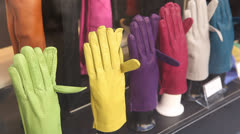Colorful gloves on store display Stock Footage