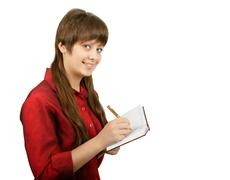smiling girl with a notebook - stock photo