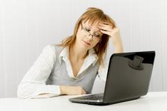 tired worker in the office - stock photo