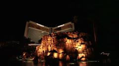 Mirage Hotel Resort public pool volcano night HD 1172 Stock Footage