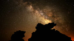 Stock Video Footage of Astro Time Lapse Milky Way with Volcanic Formation Zoom In (Fossil Falls)