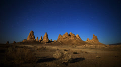 Stock Video Footage of Astro Time Lapse with Hoodoos and Moon Shadow  (Trona Pinnacles)