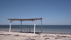 Beach and sea, straw sunshade and blue sky Stock Footage