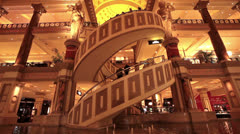 Spiral escalator stairs luxury hotel resort casino Caesars Palace fast timela - stock footage