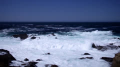 Foamy white waves crashing against the rocks at Big Sur, California - stock footage
