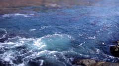 Gentle waters off of the coast at Big Sur, California Stock Footage