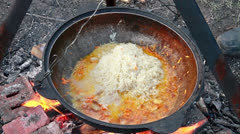 Cooking pilaf. Flatten rice  Stock Footage