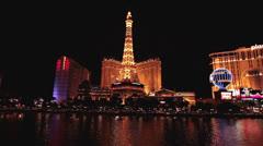 Las Vegas Strip hotel resort casino across water lake night HD 1190 Stock Footage
