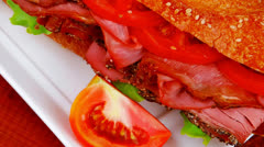 Sandwich on plate : french long baguette Stock Footage