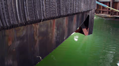 Stained Bow of Tugboat with Glowing Green Water Ripples Stock Footage