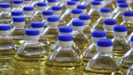 Stock Video Footage of Sunflower Oil in a Bottle
