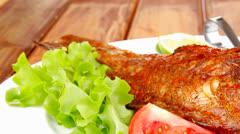 Savory on plate : roast golden fish Stock Footage