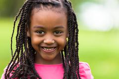 outdoor close up portrait of a cute young black girl - african people - stock photo
