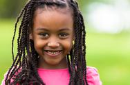 Stock Photo of outdoor close up portrait of a cute young black girl - african people
