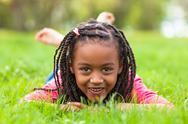 Stock Photo of outdoor portrait of a cute young black girl smiling - african people