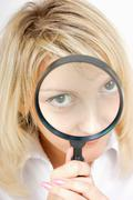 Girl with a magnifying glass Stock Photos