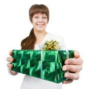 young woman with a gift on a white background - stock photo