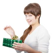 Stock Photo of attractive young woman with a gift on a white background