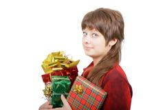 Attractive young woman with gift boxes Stock Photos