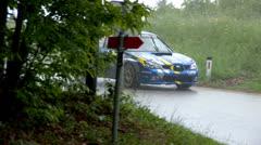 Car drifting through wet corner Stock Footage