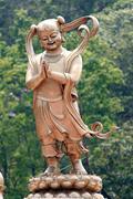 chinese deities sculpture. - stock photo