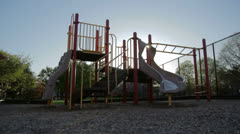 Red and Yellow Playground Silhouetted - stock footage