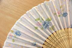 Focus chinese fan flower pattern. Stock Photos