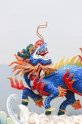 the sculpture dragon and horse combination. - stock photo