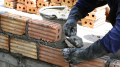 labor build brick in construction site - stock footage