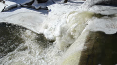 Closeup river cascade corner edge water splash bubble ice frozen Stock Footage