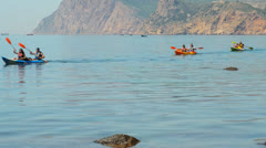 Traveler kayaking in the Black sea from backward view Stock Footage