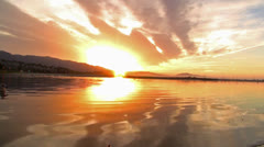 Sunrise on the Beach Reflection Real Time Birds Flyover Stock Footage