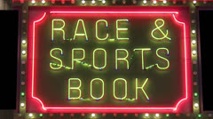 Race and sport book neon sign loop Stock Footage