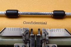 confidential text on typewriter - stock photo
