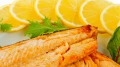 Grilled salmon and lemon on white Stock Footage