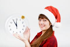 attractive girl with a clock - stock photo