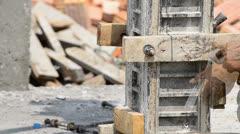 labor build pillar in construction site - stock footage