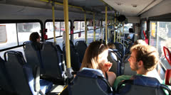 A couple talks while riding a metropolitan bus in Porto Alegre, Brazil. Stock Footage
