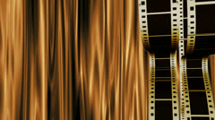 Filmstrips on golden curtain Stock Footage