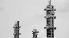Black and white labor build pillar in construction site Stock Footage