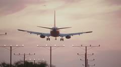 Landing Airplane in Los Angeles at sunrise 2 Stock Footage