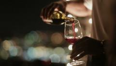 Waiter pours wine into a glass 2 Stock Footage