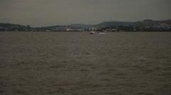 Catamaran and jet skies against Porto Alegre skyline (PoaGuaiba 04) Stock Footage