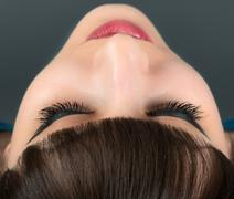 Stock Photo of close-up of relaxed young woman with closed eyes.