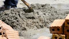 labor mix cement in construction site - stock footage