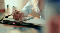 Business woman writing in a notebook - stock footage